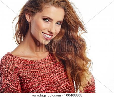 Portrait of wonderful young woman with long hair looking at camera