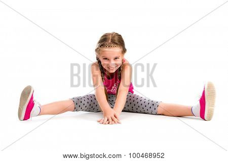 little girl doing yoga isolated on white background