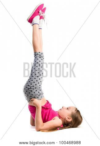 little girl with legs up exercise isolated on white background