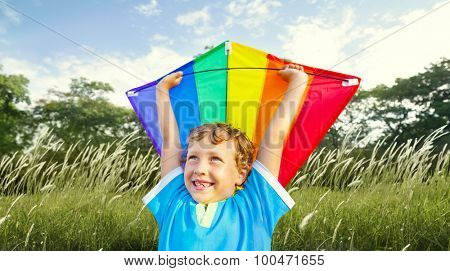 Little Boy Playing Kite Park Windy Concept