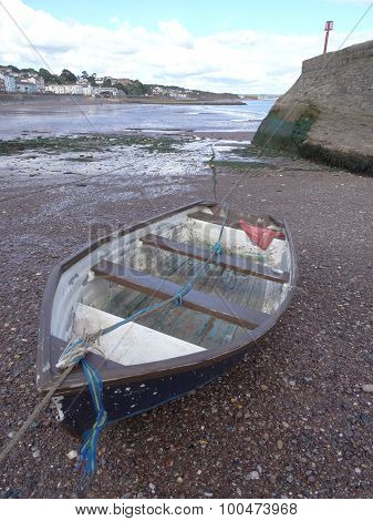 Boat On A Beach Within Harbour