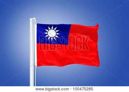 Flag of Taiwan flying against a blue sky.