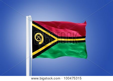 Flag of Vanuatu flying against a blue sky.