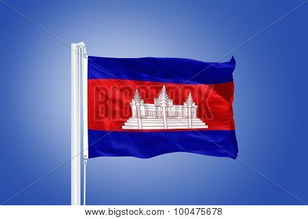 Flag of Cambodia flying against a blue sky.