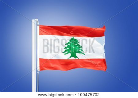 Flag of Lebanon flying against a blue sky.