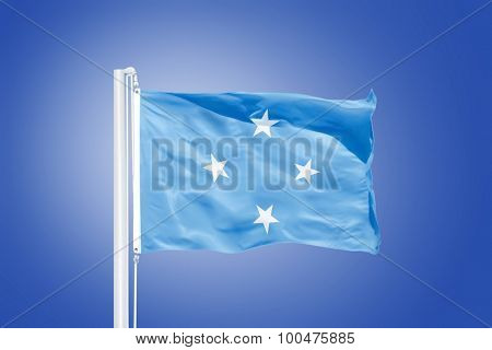 Flag Federated States of Micronesia flying against a blue sky.