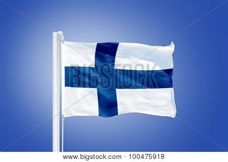 Flag of Finland flying against a blue sky.