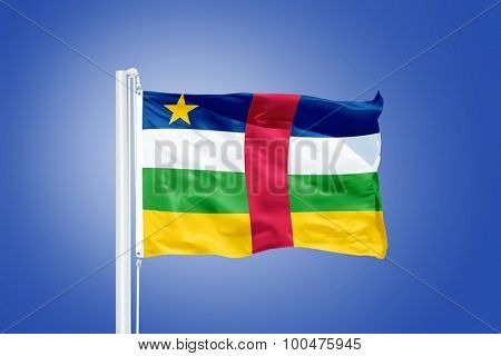 Flag of Central African Republic flying against a blue sky.