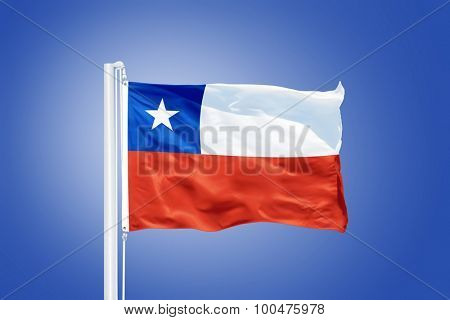 Flag of Chile flying against a blue sky.