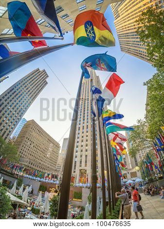 NEW YORK,USA - AUGUST 14,2015 : Tourists at the Rockefeller Center in downtown Manhattan
