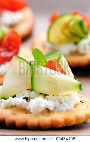 Bite size canapes with ricotta cheese and zucchini