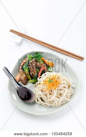 Stir fry beef asian chinese noodles with vegetables, plenty of copy space