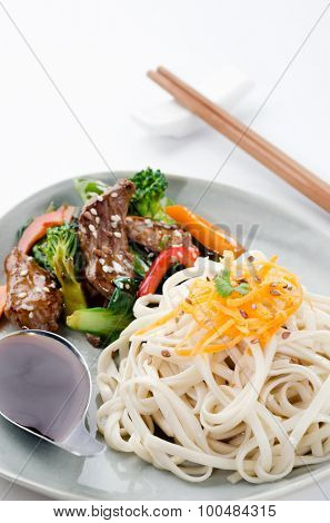 Oriental noodles with side portion of beef stir fry and vegetables
