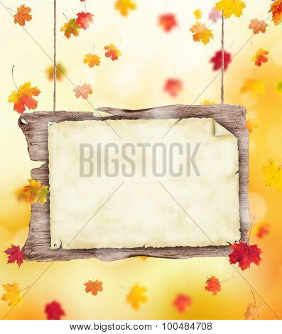 autumn leaves background with wooden blank poster