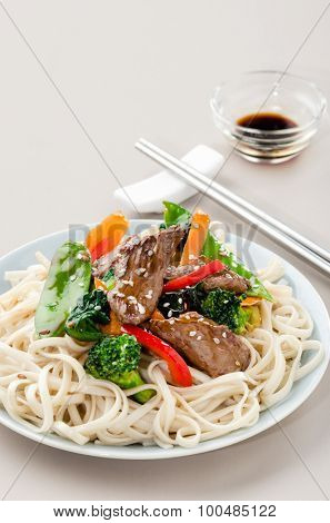 Beef stir fry with broccoli vegetables and noodles on a plate