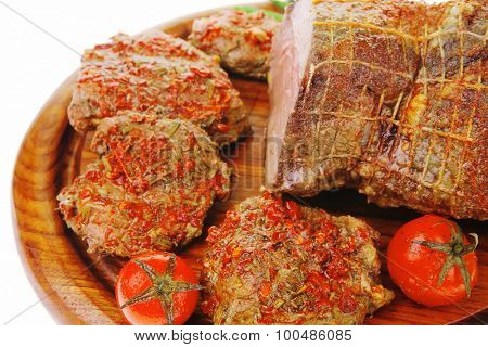 meat chops with green chives on wooden plate