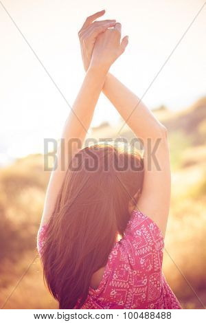 woman enjoy in summer breeze, back shot, outdoor shot on glade