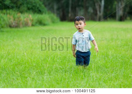 Baby boy running at park