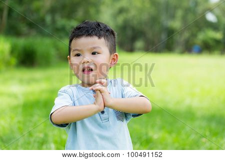 Asian baby boy with finger cross already for play