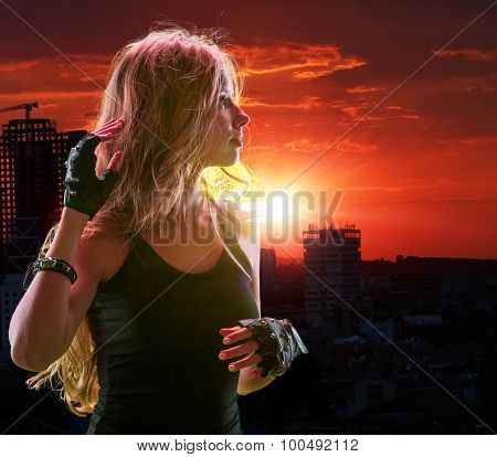 Teen girl in city looking sunset. Urban style
