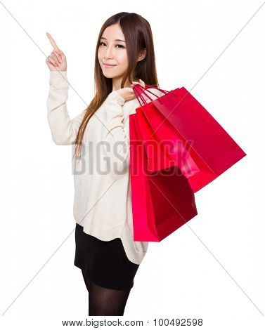 Woman hold with shopping bag and finger up