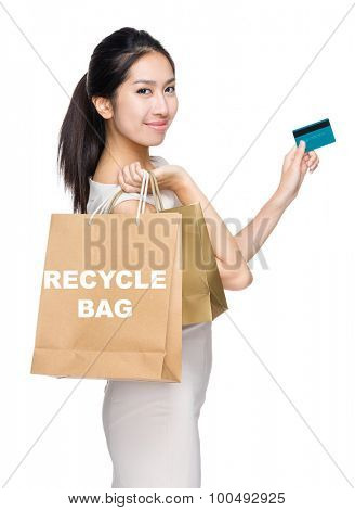Woman with credit card and holding shopping bag for showing recycle bag