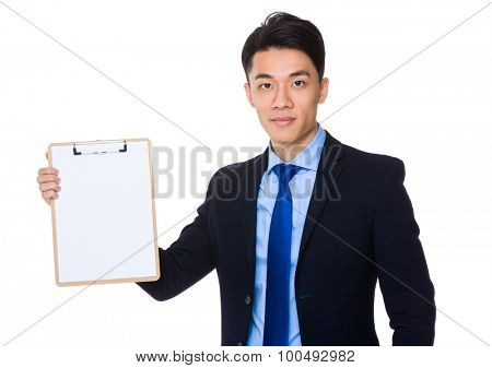 Asian businessman showing the clipboard with blank page