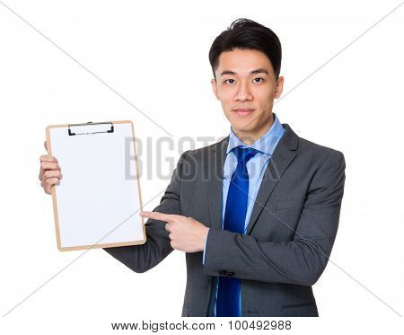 Asian young businessman finger point to clipboard