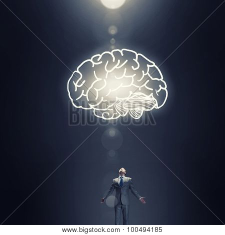 Businessman with hands spread apart and big human brain