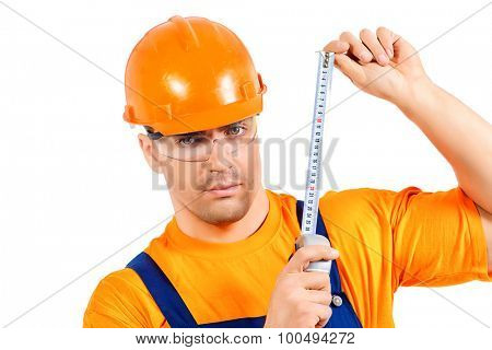 A construction worker working with tape measure. Job, occupation. Isolated over white.