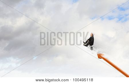 Young funny businessman riding three wheeled bicycle