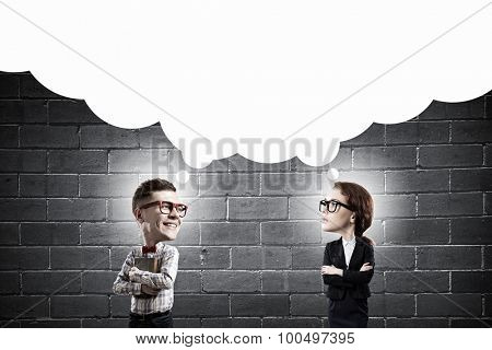 Young funny big headed man and woman in glasses