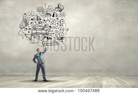 Young businessman lifting his great business plan above head
