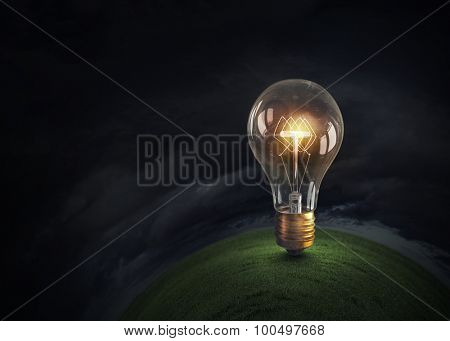 Glowing glass light bulb on dark bakground