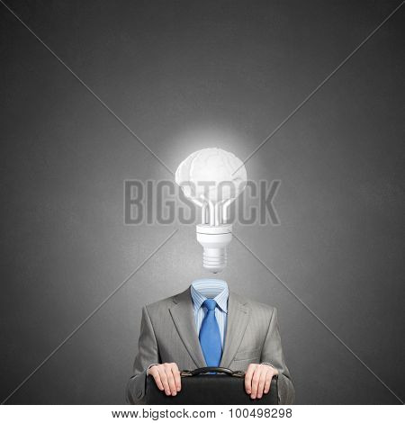 Businessman with suitcase and light bulb instead of head