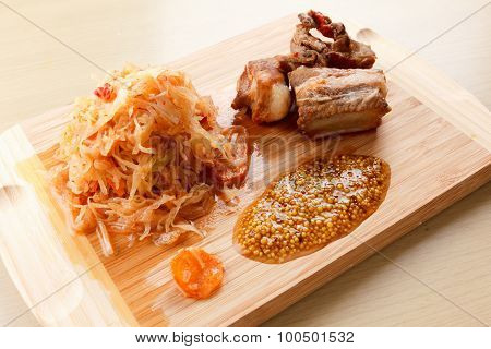 Ready Roasted Pork Ribs With Tomato, Carrots And Cabbage On A  Cutting Board