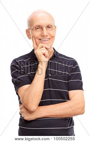Vertical studio shot of a senior gentleman smiling and looking at the camera isolated on white background