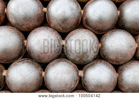 Cannon Balls Arranged In A Pile Background