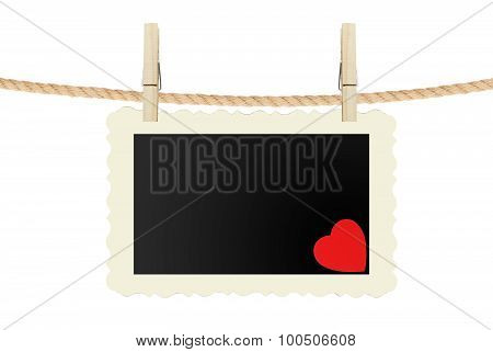 Photo Card With Red Heart Hanging On Rope Isolated On White
