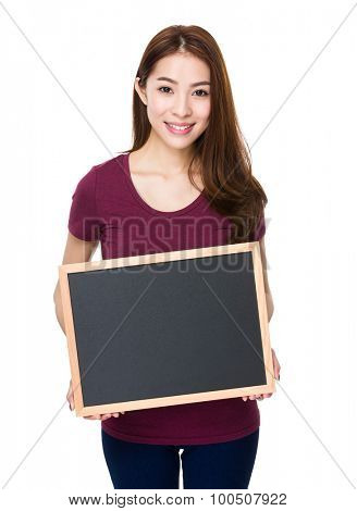 Woman showing with blank of chalkboard