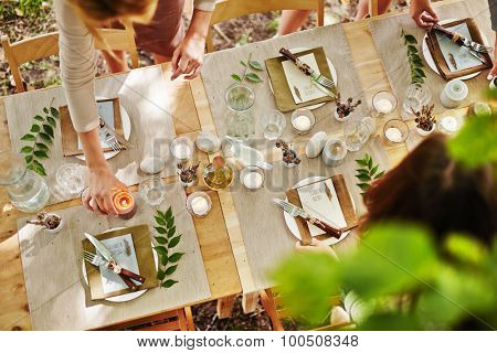 Festive table being served by girls