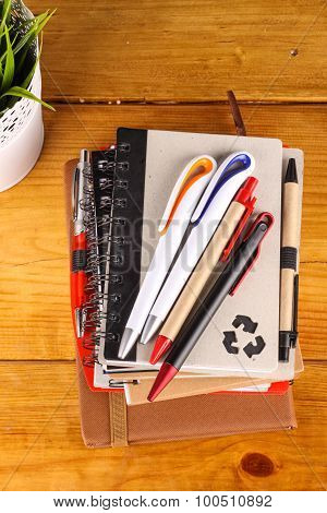 notebook and pen placed on a table