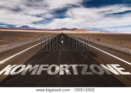 Comfort Zone (in German) written on desert road