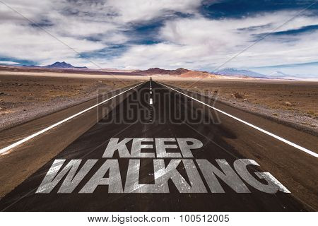 Keep Walking written on desert road