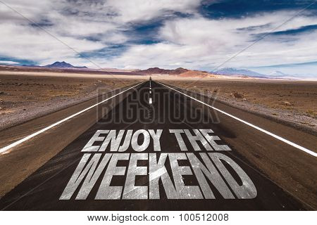 Enjoy the Weekend written on desert road