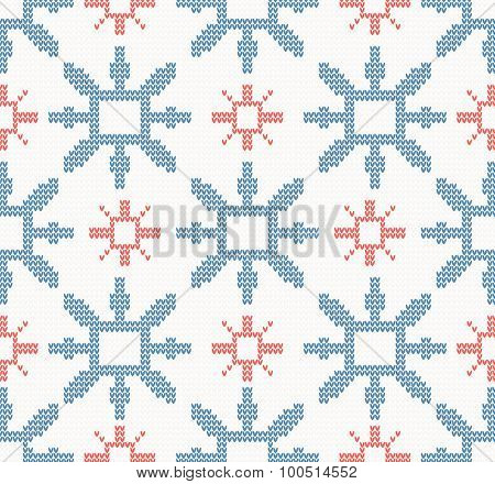 Christmas knitted pattern with blue and red snowflakes on a white background