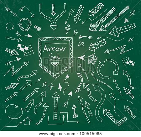 Hand drawn arrow icons set on green chalk board