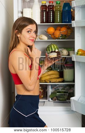 Sporty Woman By The Fridge