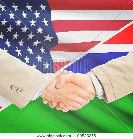 Businessmen Handshake - United States And Gambia