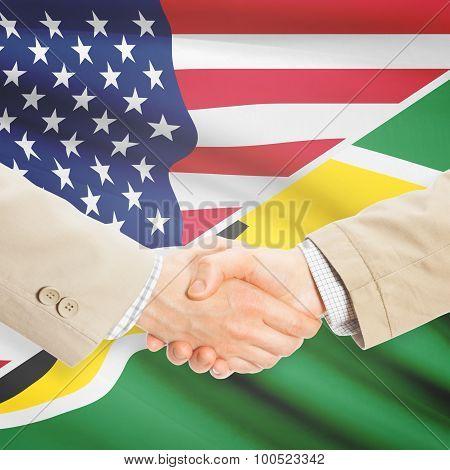Businessmen Handshake - United States And Guyana